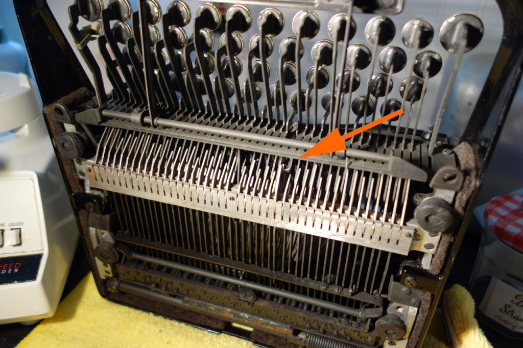 Thumb nut wedged inside typewriter